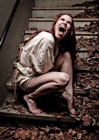 straight jacket: an insane psycho girl wearing a straight jacket