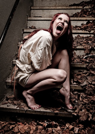 straight jacket: an insane vampire girl wearing a straight jacket Stock Photo