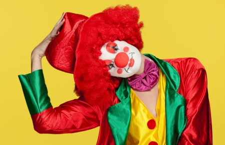 performer: a female clown with colorful clothes and makeup