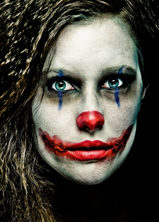 close up of a scary looking female clown
