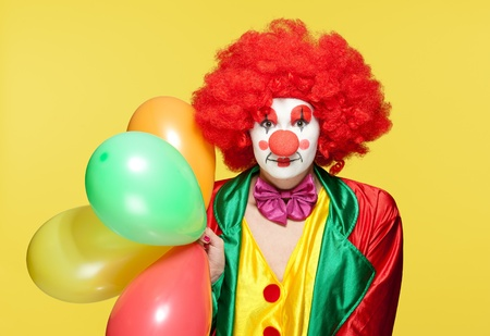 a female clown with colorful clothes and makeup Stock Photo - 11095008