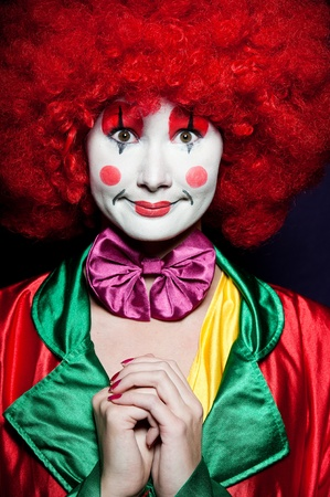 carnival clown: a female clown with colorful clothes and makeup