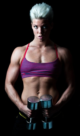 a young muscular fitness girl striking a pose photo