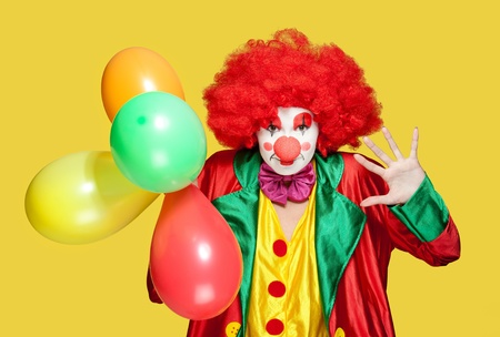 a female clown with colorful clothes and makeup Stock Photo - 11154029