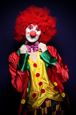 clowns: a female clown with colorful clothes and makeup