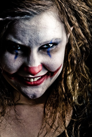 close up of a scary looking female clown photo