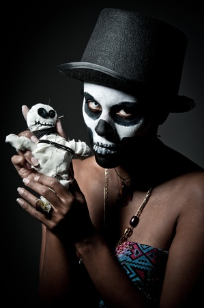 deadman: a female voodoo priestess with face paint