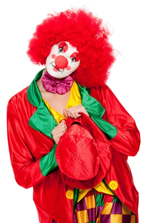a female clown with colorful clothes and makeup photo