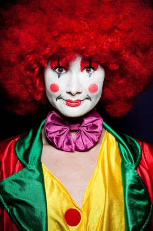 comedy show: a female clown with colorful clothes and makeup