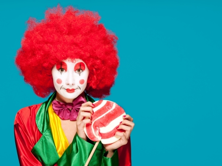 a female clown with colorful clothes and makeup Stock Photo - 11309445