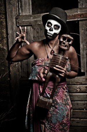 priestess: a female voodoo priestess with face paint