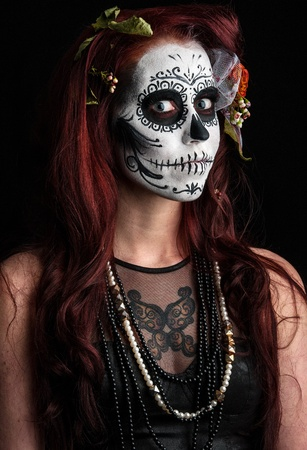 a woman with her face painted as a traditional day of the dead sugarskull mask Stock Photo - 12517705