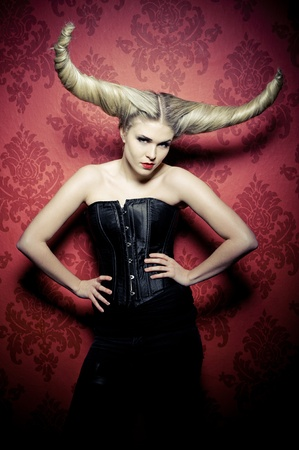a beautyshot with a blonde female with a wicked hairstyle Stock Photo - 12518528