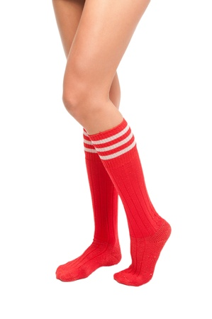football socks: a close up of female legs with soccer socks