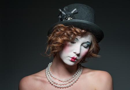 a girl dressed up as an old vintage porcelain doll Stock fotó