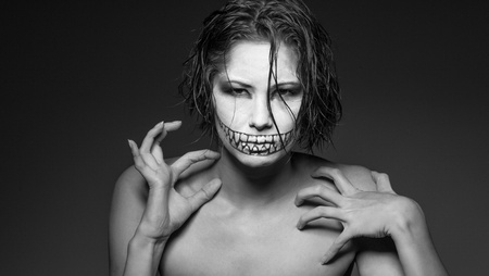 evil girl: a young girl with creative face paint Stock Photo