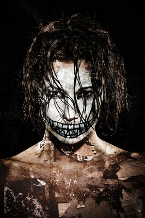 evil woman: a scary looking girl with face paint
