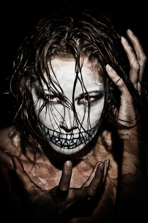 a scary looking girl with face paint photo