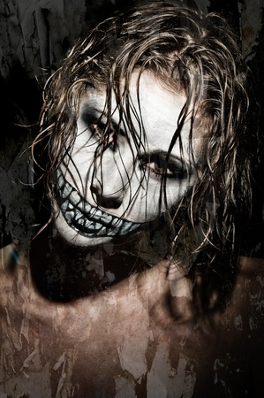 evil girl: a scary looking girl with face paint