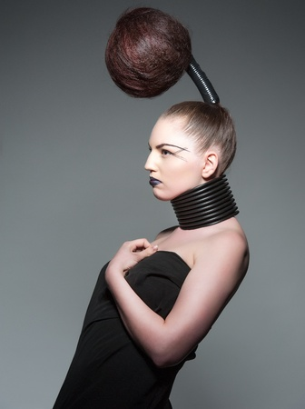 a young model with a creative avantgarde hairstyle photo
