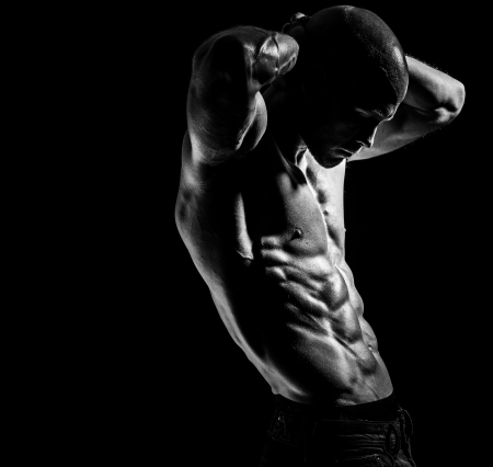 a young fit athlete posing his ripped body photo