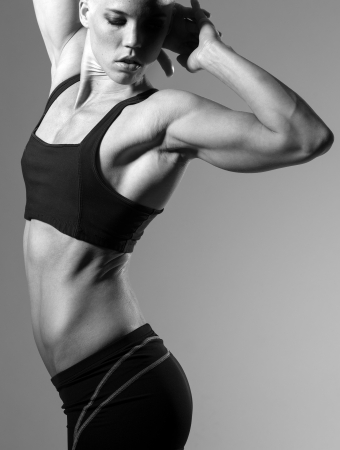 flex: a very fit woman posing her muscular body