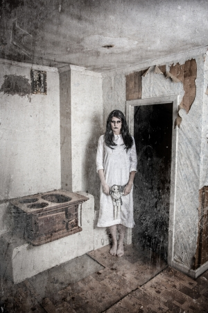 a scary haunted ghost girl in a rural setting photo