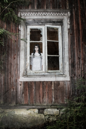 a scary haunted ghost girl in a rural setting Stock Photo - 15896245