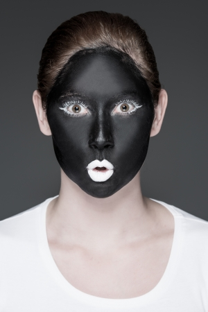 a young girl with black and white makeup photo