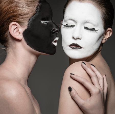 yang ying: two young girls with ying yang style makeup Stock Photo