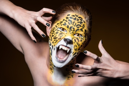 costume: a young girl with a wild and creative leopard make up