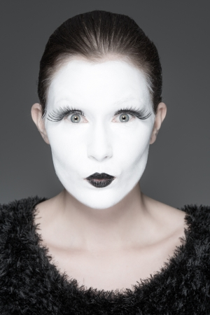 a young woman with a whiteface makeup photo