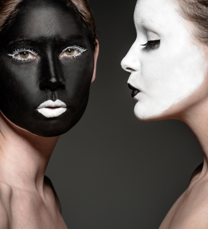 two young girls with ying yang style makeup Stock Photo