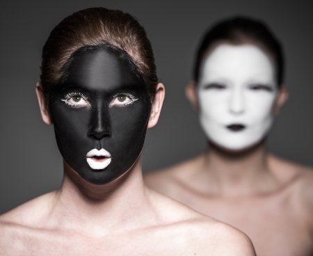 yang style: two young girls with ying yang style makeup Stock Photo