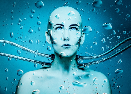 alien women: an underwater robot girl connected with metal cables
