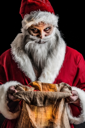 a evil looking santa with a glowing bag photo