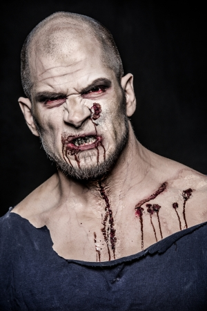 crazy man: a scary and bloody zombie man