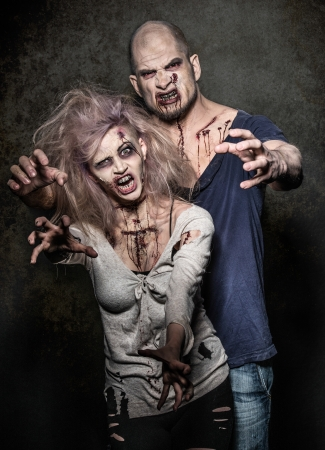 a bloody pair of scary evil zombies photo
