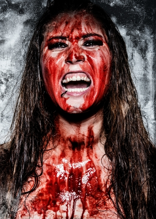 a scary horror girl covered in blood Stock Photo