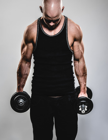 dumbell: a young and very fit man Stock Photo