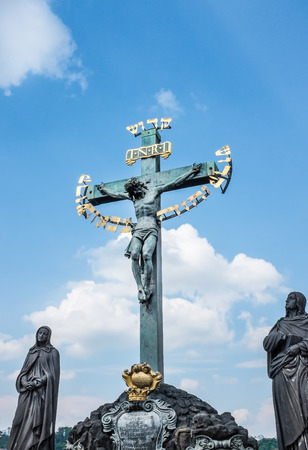 Religious statue on the famous Charles Bridge in Prague city center