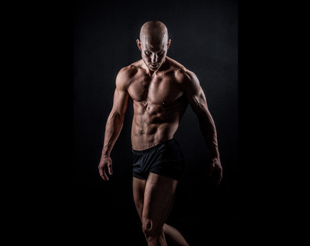 a muscular athletic male with shaved head