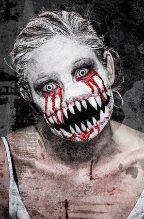 a scary demon woman with big sharp teeth Stock Photo