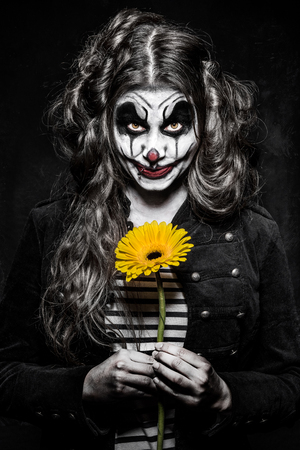 scary girl: a scary evil clown girl with a wicked makeup Stock Photo