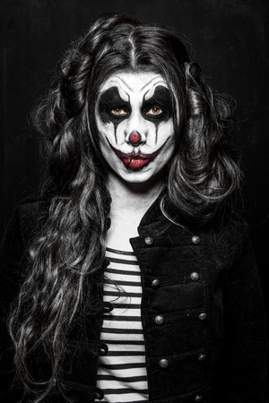wicked: a scary evil clown girl with a wicked makeup Stock Photo