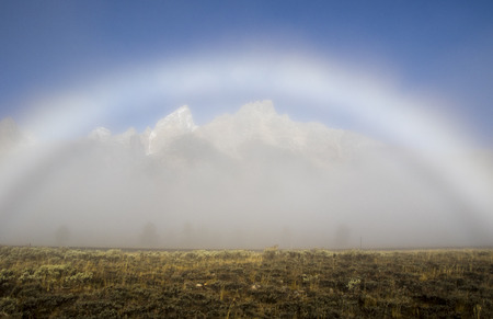 Fogbow forms over the Tetons on a foggy evening in the fall