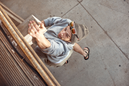 man jumping and climbing on wooden wall
