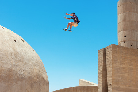 risky man jumping, in little motion blur