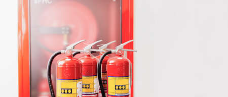 The red fire extinguisher is ready for use in case of an indoor fire emergency. 写真素材