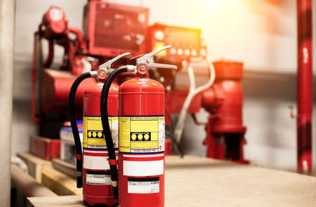 The red fire extinguisher is ready for use in case of an indoor fire emergency.